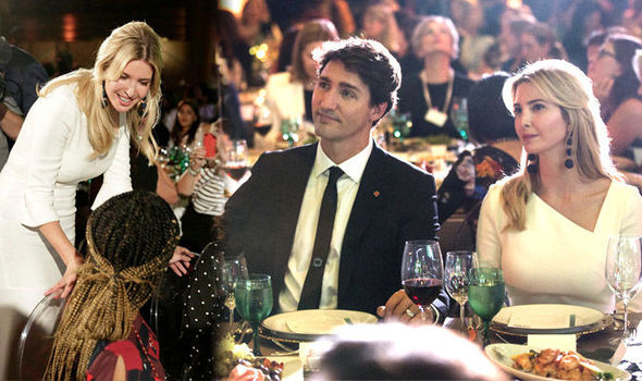 Ivanka Trump reveals hint of chest as she cosies up to Justin Trudeau and wife at event