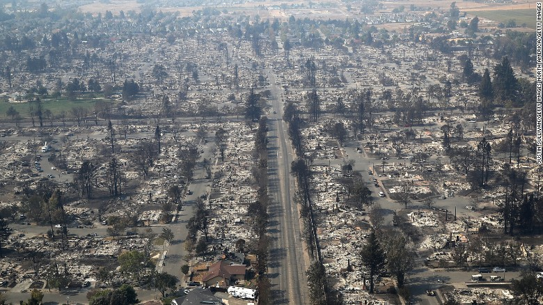 California fires: Searchers seek hundreds of missing