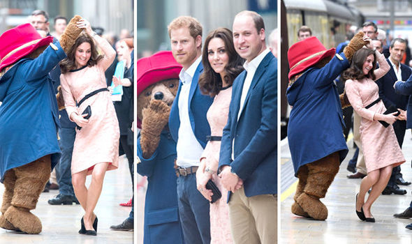 DANCING QUEEN! Kate with baby bump on full show jives with Paddington Bear