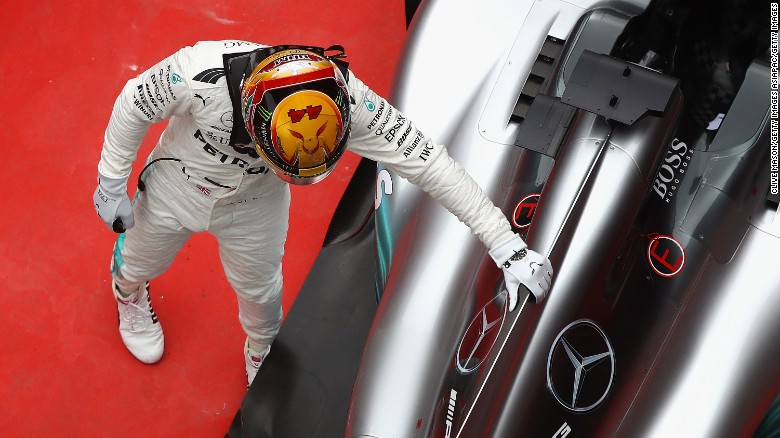 Lewis Hamilton survives collision to win fourth Formula One world title