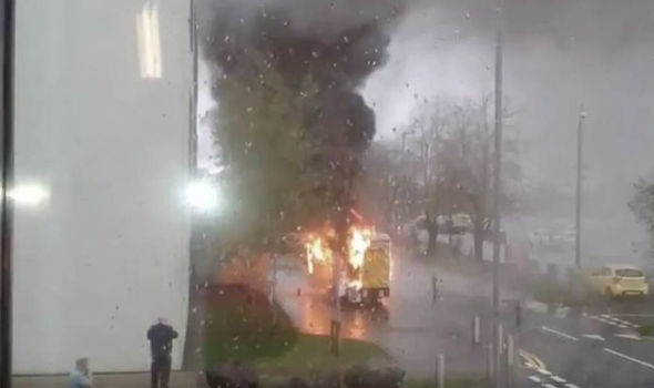 BREAKING: Ambulance bursts into FLAMES outside Glasgow hospital