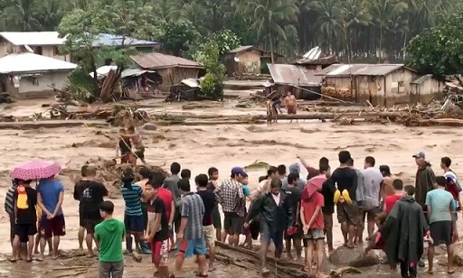 More than 120 killed in Philippines mudslides and floods as storm hits