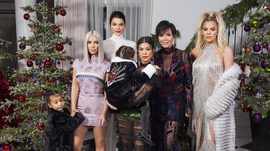 Kourtney Kardashian Jokes About Pregnant Kylie Jenners Absence in New Family Christmas Picture