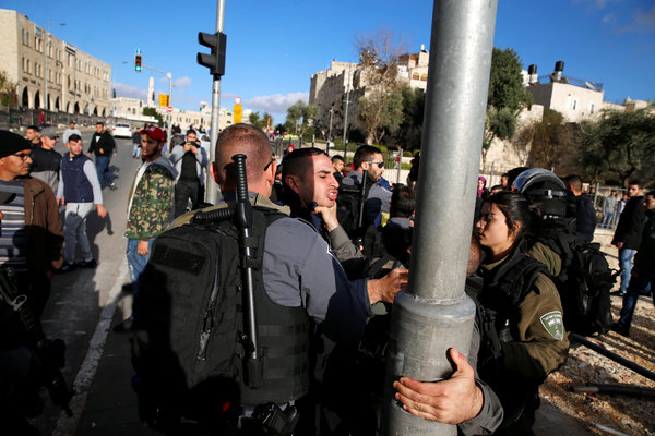 Israeli Police Fire Tear Gas And Stun Grenades On Palestinian Protestors