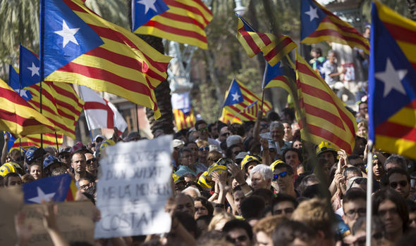 Spain in CRISIS: Troops sent in as 40,000 protest over WAR on Catalan independence vote