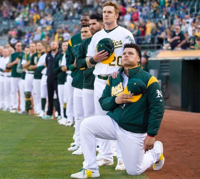 Bruce Maxwell is the first MLB player to kneel during the national anthem