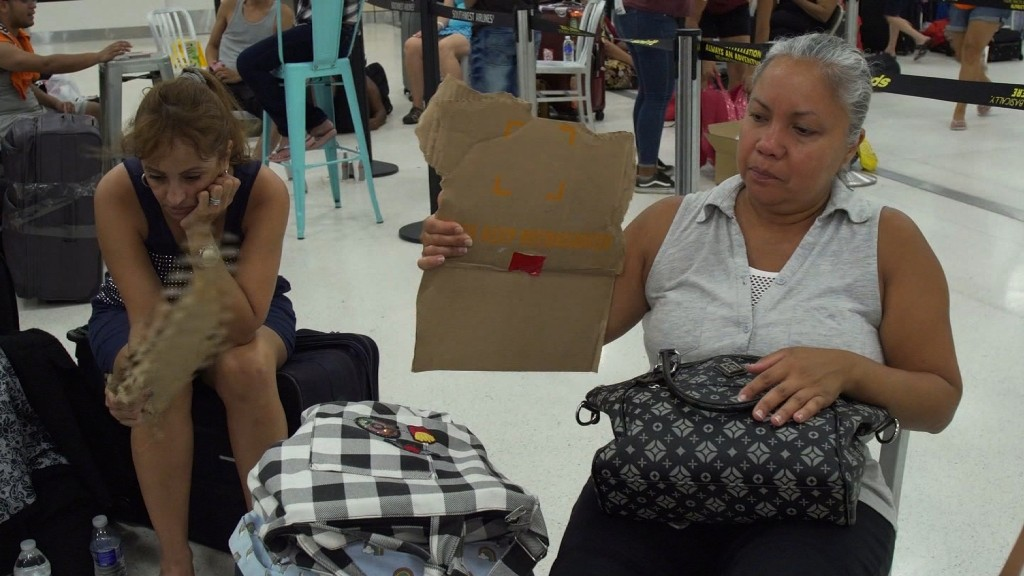 Passengers in Puerto Rican airport have little water or food, no working ATMs and no idea when theyll leave