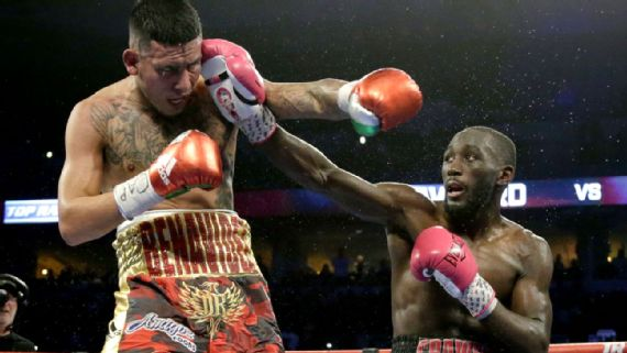 Crawford outclasses Benavidez Jr. to keep title