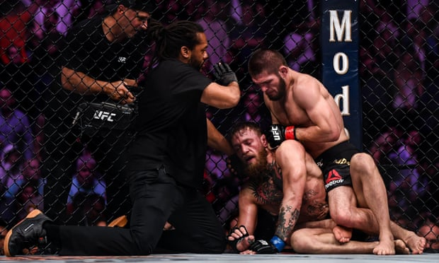 Khabib Nurmagomedov taps out Conor McGregor then sparks melee in crowd