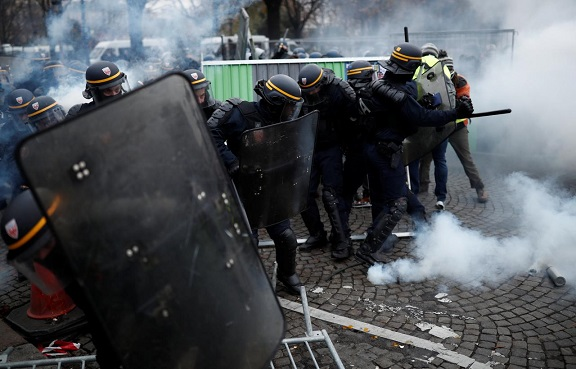 French police fire tear gas at protesters on Champs Elysees