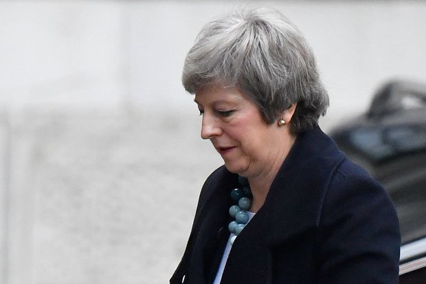 Britains Theresa May delays key Brexit vote