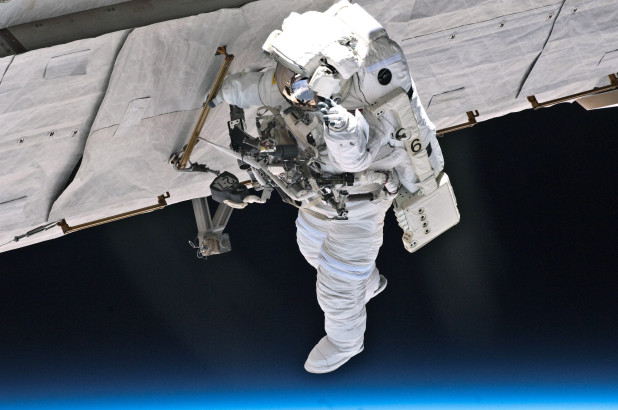 Space station crew to inspect mysterious hole on 6-hour spacewalk