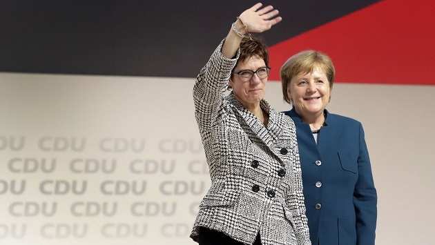 Germany's ruling party selects new chair to succeed Angela Merkel, who remains chancellor