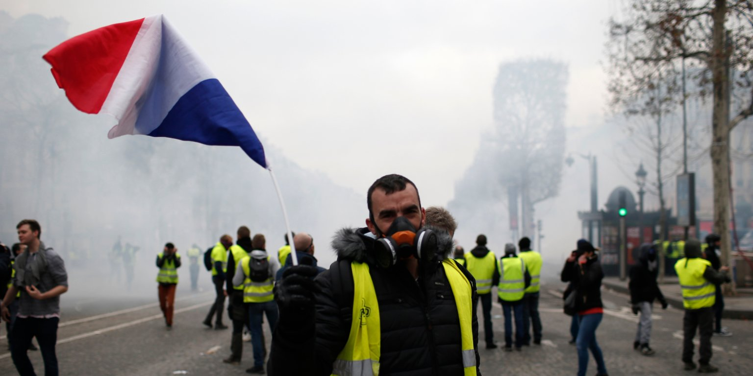 More than 1,300 were arrested and dozens injured after violent anti-government protests engulfed France