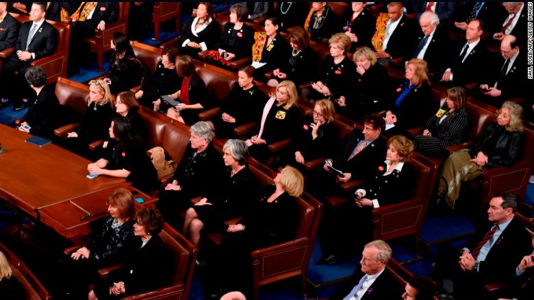 The first ladys cream suit, kente cloth and purple ribbons: What the SOTU fashion choices meant