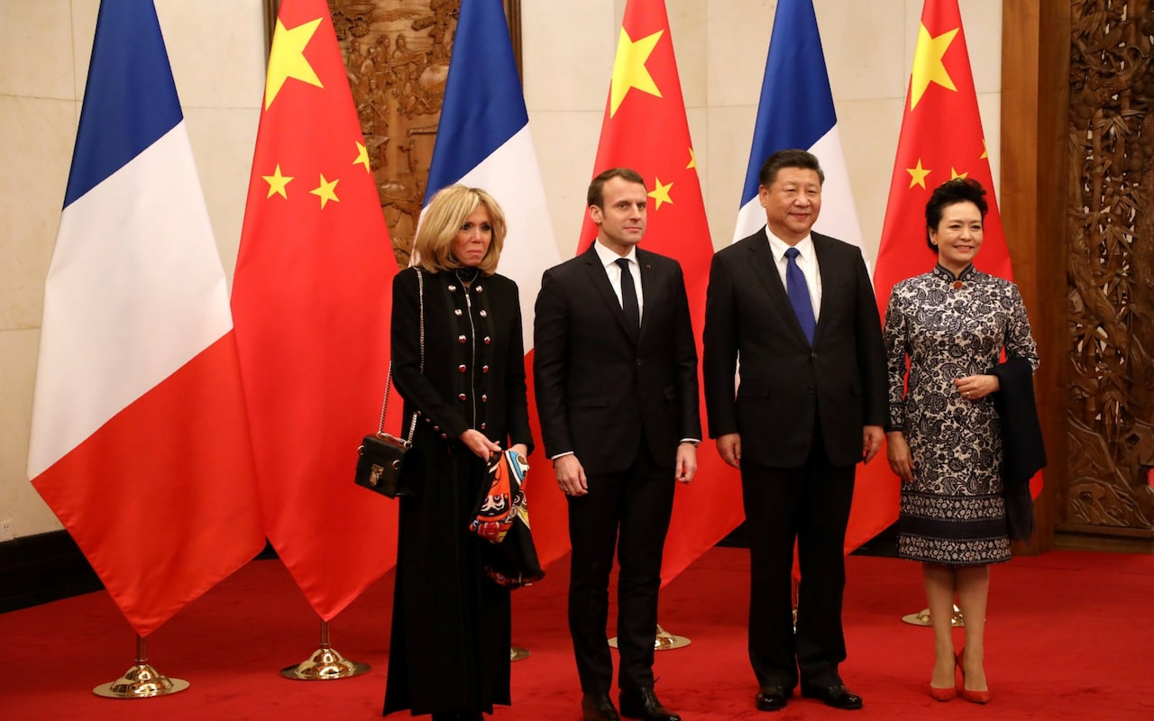 Emmanuel Macron calls for stronger EU ties with China, as he gives Xi Jinping a horse on first visit