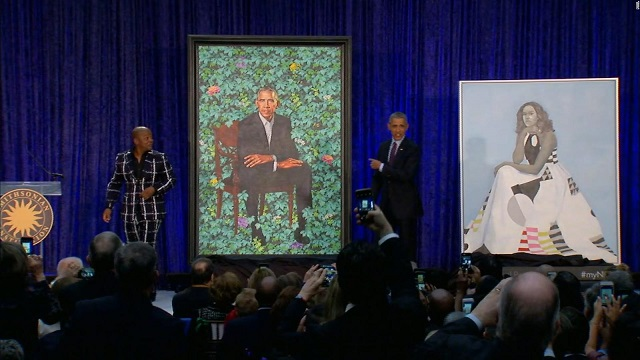 Obamas official portraits unveiled