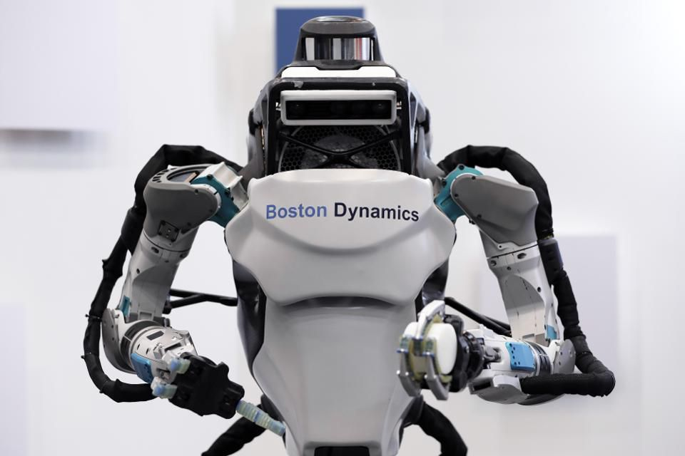 Watch Boston Dynamics' Creepy Robot Dogs Team Up To Enter