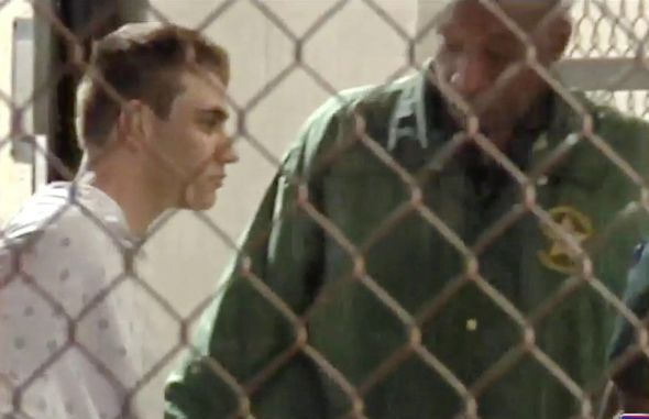 Florida shooting: First look as Nikolas Cruz arrives at jail, handcuffed in hospital robe