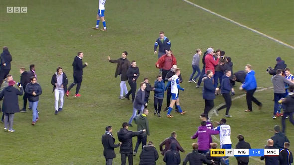 Man City star Sergio Aguero PUNCHES Wigan fan after shocking FA Cup defeat - WATCH