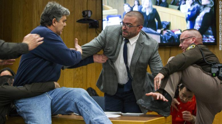 Father lunges at Nassar in court before being restrained
