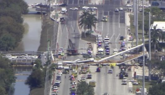 Miami pedestrian bridge collapses, injuring multiple people and crushing several cars
