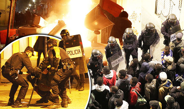 Spain in CHAOS: Streets of Spanish capital Madrid in FLAMES as SHOCKING riots break out