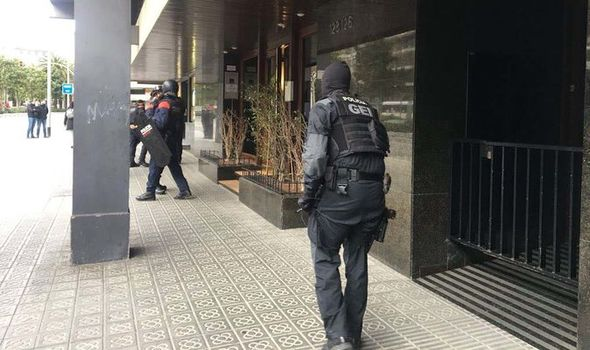 Barcelona embassy hostage situation: Diplomats wife held as police surround building