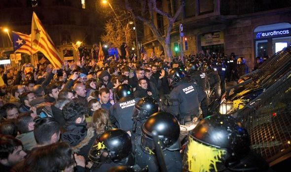 Violent protests break out in Barcelona - riot police on scene