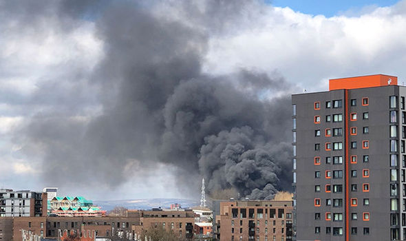 HUGE fire in Manchester city centre as black smoke fills the sky