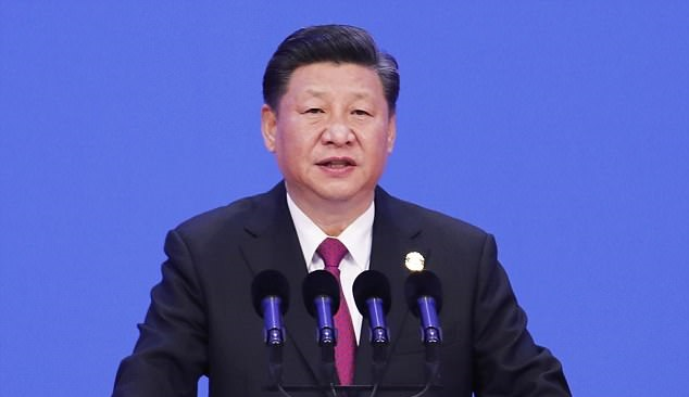 China's Xi promises to cut car import tariffs, buckles in trade war