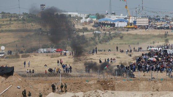 The Latest: Israeli troops fire at Gaza protests; 9 wounded