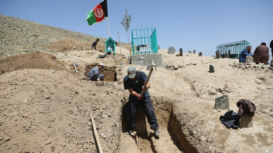 The Latest: Taliban attack checkpoint, kill 5 Afghan troops