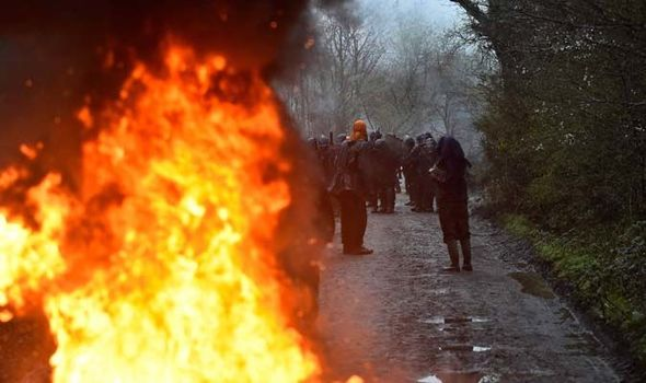 FRANCE RIOTS: Tear gas fired as THOUSANDS of police clash with anti-capitalist protestors