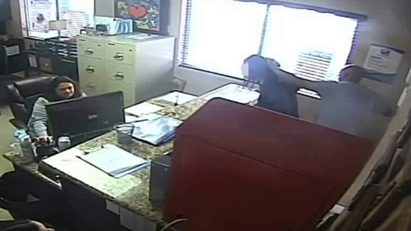 Video: Cop beat up teen daughter in school office as employees looked on