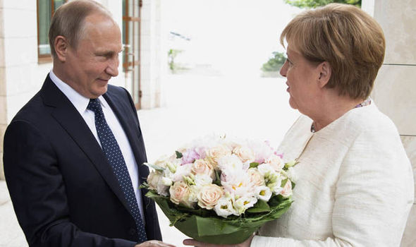 Flowers for Merkel as pair meet on back of Trump pressure