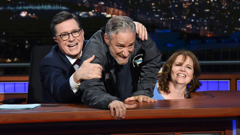 Jon Stewart Camps Out Under Stephen Colberts Desk With Charity Contest Winner