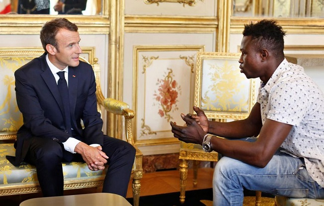 Macron rewards migrant hero who saved dangling child in Paris