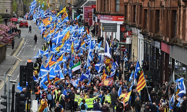 Thousands of Scottish independence supporters march through Glasgow