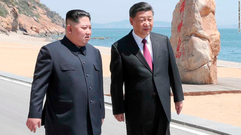 Kim Jong Un makes unexpected trip to meet China's Xi
