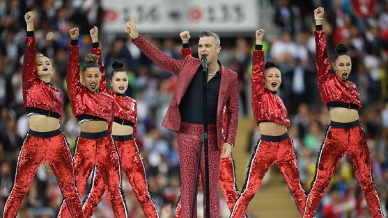 Fox Apologizes for Robbie Williams Obscene Gesture at World Cup