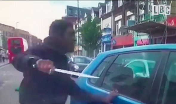WATCH: TERRIFYING video shows FURIOUS cyclist pulling HUGE knife at driver