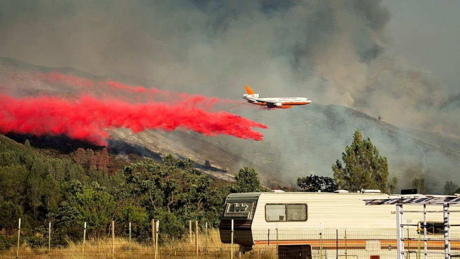 Thousands flee as flames race across dry rural California