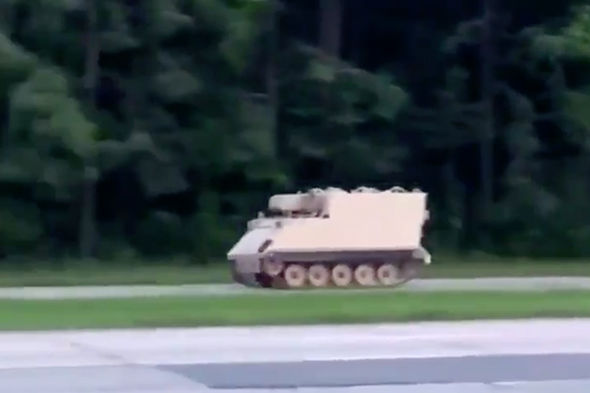 Social media in MELTDOWN as video emerges of police chasing STOLEN TANK in Virginia, US