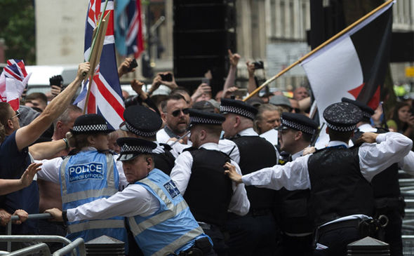 Tommy Robinson march: Five police officers injured as London rally spirals out of control