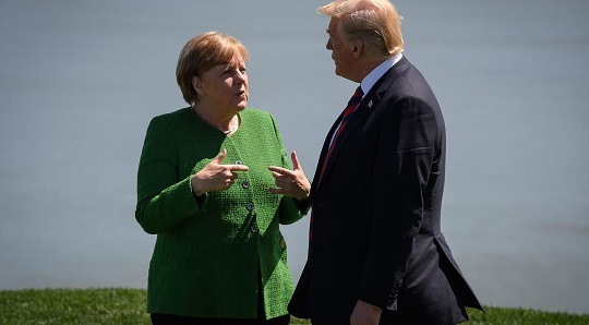 Merkel proposes trade dispute body as G7 summit begins