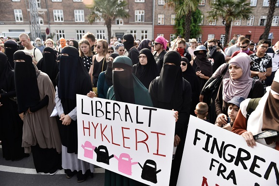 Protests in Denmark as burqa ban comes into effect