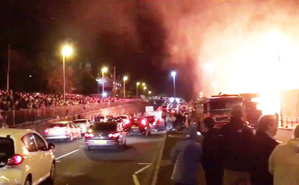 Northern Ireland shock video: Horror as hundreds CHEER burning of UK flag & poppy wreaths