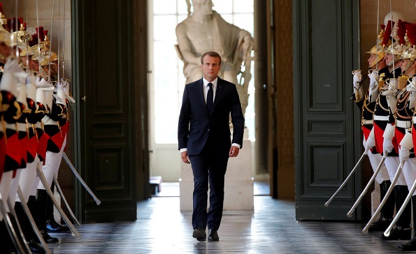 Macron tells critics to 'come get him,' knowing they can't