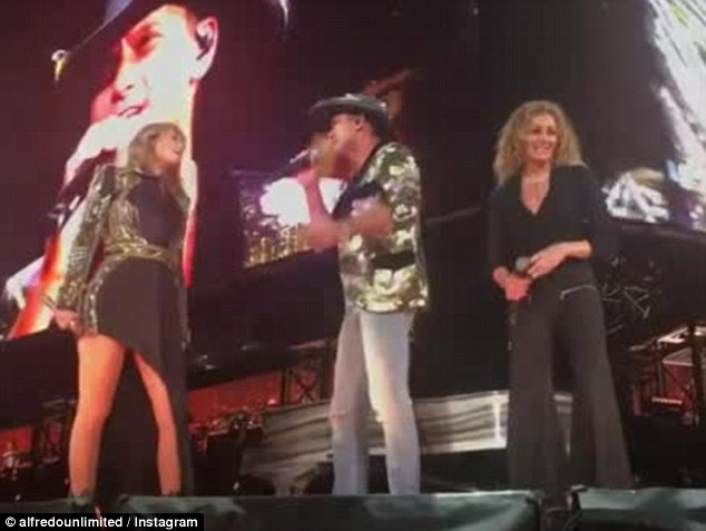 Taylor Swift surprises fans as she brings Tim McGraw and Faith Hill on stage to perform